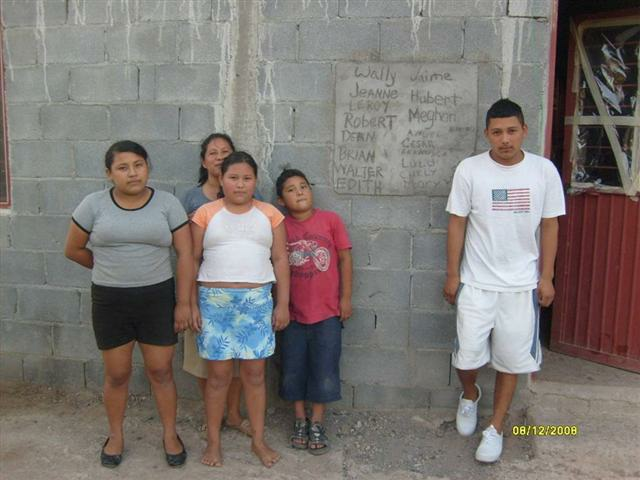 A grateful family in front of their completed house in Mexico