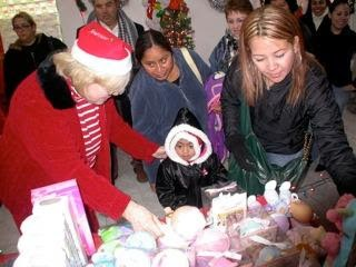 Giving out toys at a Christmas fiesta in Mexico