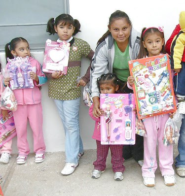 Kids with their toys at a Christmas fiesta in Miguel Aleman