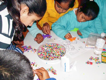 Kids doing crafts with a team in Mexico