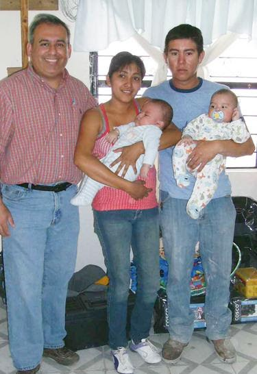 Executive Director David with a family receiving a home in Mexico