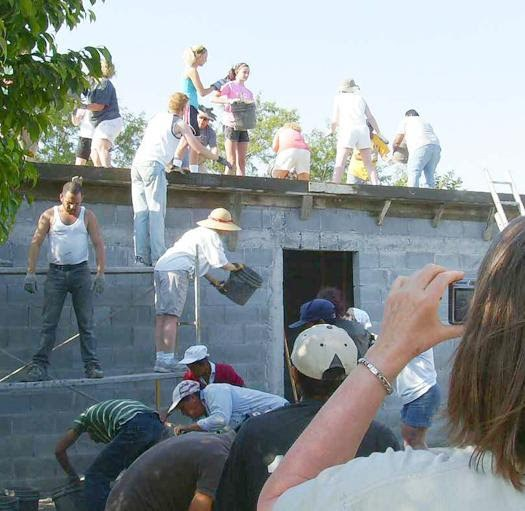A team and volunteers pouring a roof in Mexico