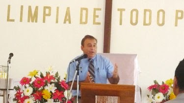 David preaching at a church event in Miguel Aleman