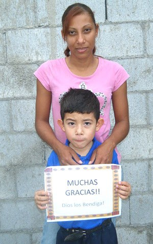 A family receiving a home in Miguel Aleman