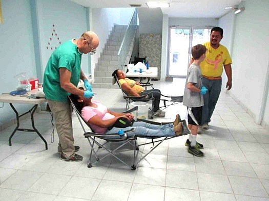 A dentist seeing patients at the clinic in Reynosa