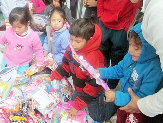 Kids getting gifts at the Christmas fiestas in Reynosa