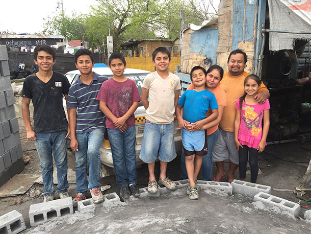 A family who received a house this month in Reynosa