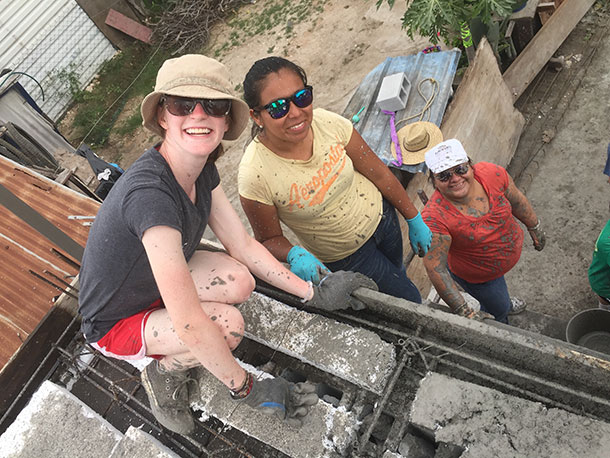 Friends during a roof pour in Mexico