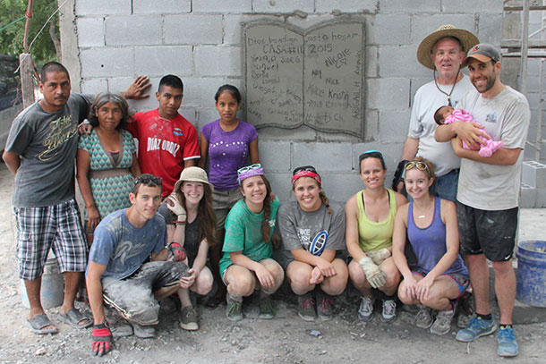 The group from North Carolina with the family they helped build a home with