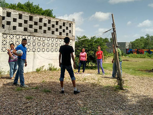Our new pastor playing volleyball with the youth in Naranjito