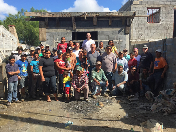The Board of Directors after pouring a roof with the staff and volunteers in Reynosa