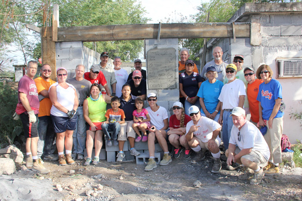 A mission work group with a family finishing up a house in Reynosa