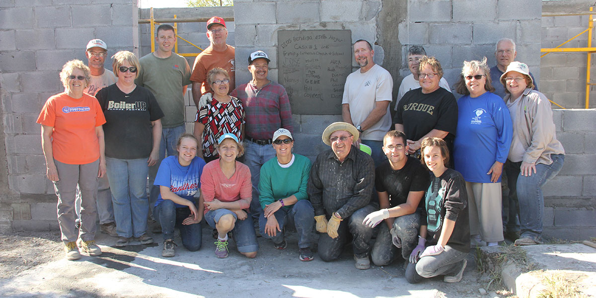 A team from Indiana with a family after helping them build a home in Reynosa