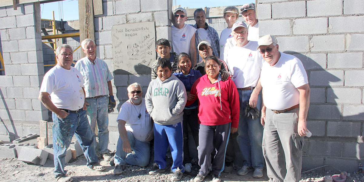 A mission work group from Indiana with a family who they built a house with in Reynosa