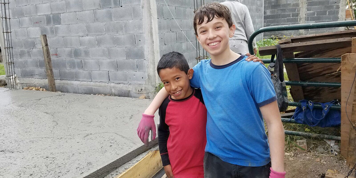 Kids work together to pour a floor in Reynosa