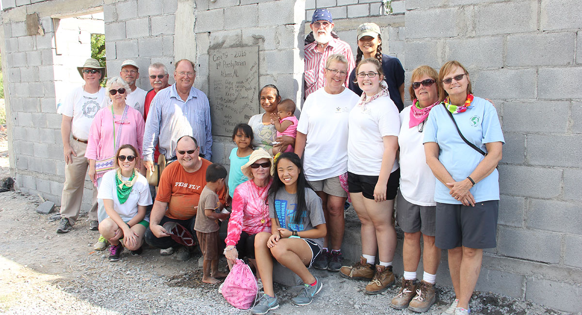 A group and a family in front of a recently completed house in Reynosa