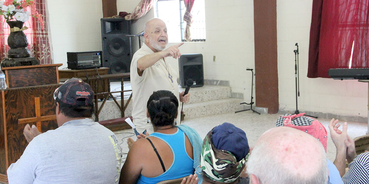 Deantin leading the dedication service in Reynosa