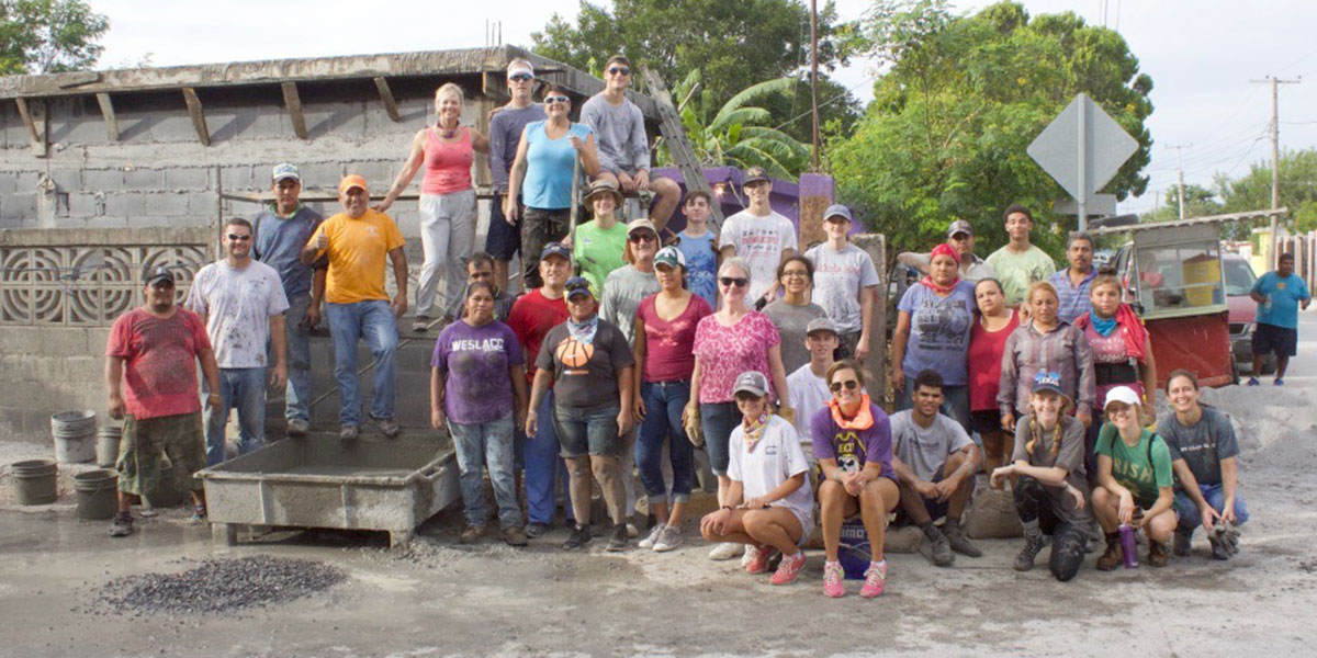 A team and the staff and volunteers in Reynosa after pouring a roof together