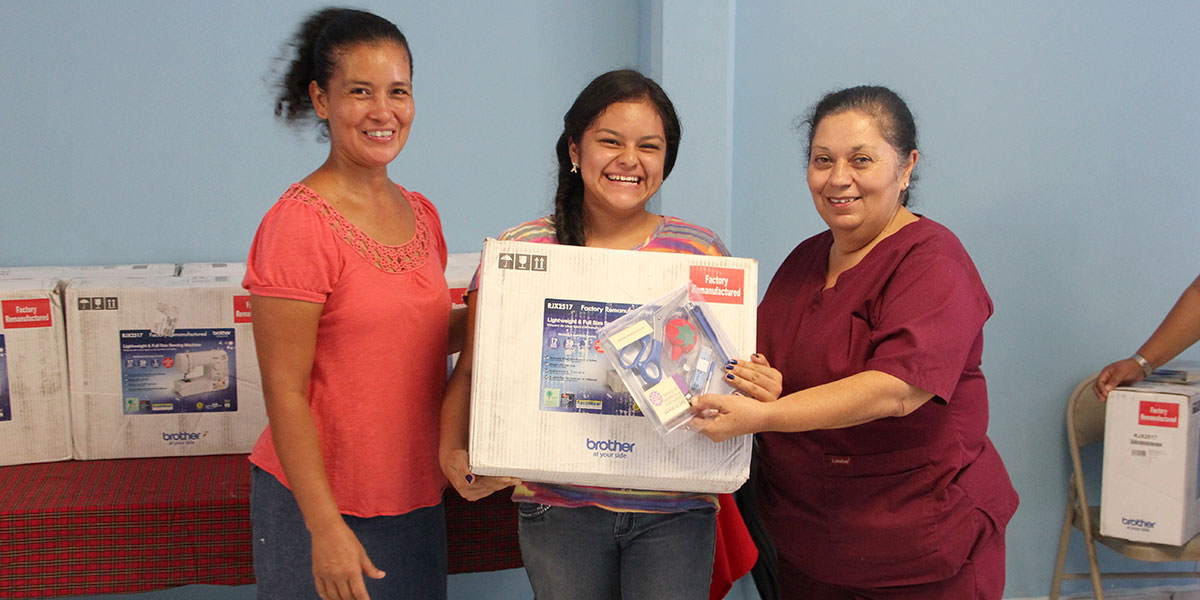 Ladies from the sewing program receiving sewing machines in Reynosa