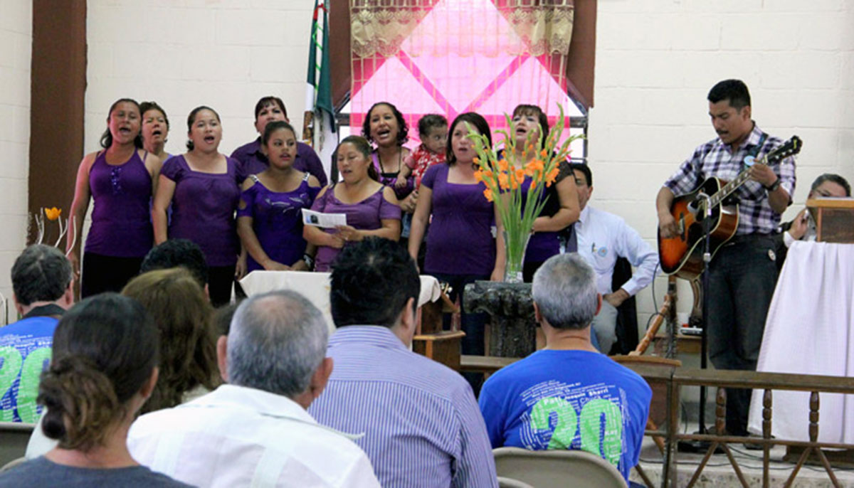 The chorus performing at the 20th anniversary celebration