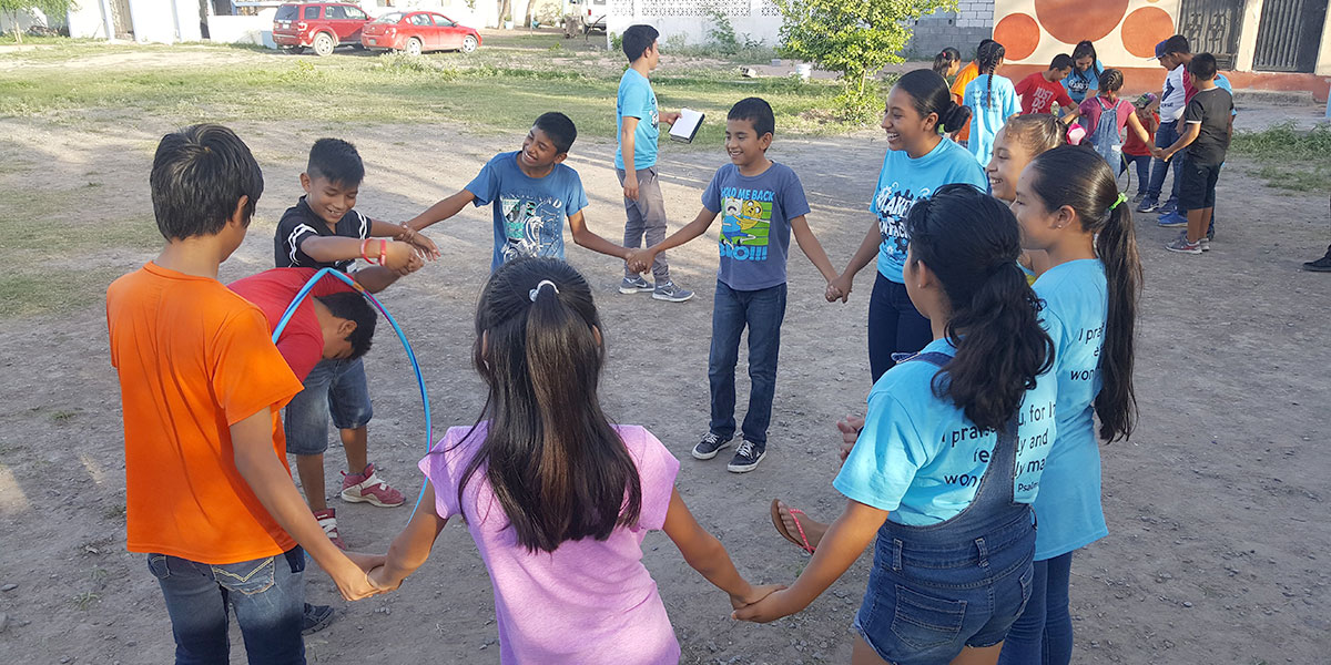 Playing games at Vacation Bible School in Naranjito