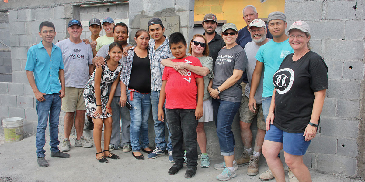 A team in North Carolina with a family receiving a house in Reynosa