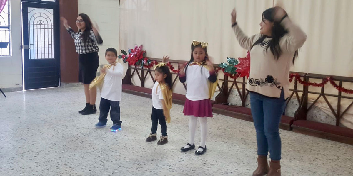 Kids performing a song at the church Christmas fiesta in Reynosa