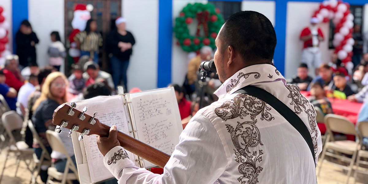 A church member performing a song at the Christmas fiesta in Miguel Aleman