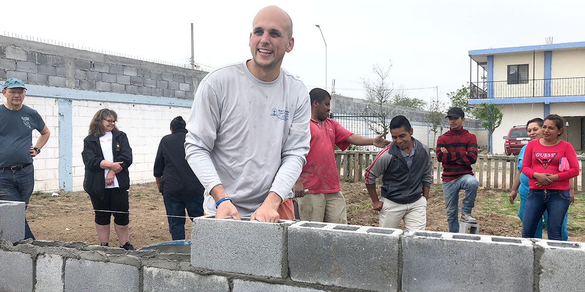 Board member Nathan laying one of the first blocks at the Deantin community center in Naranjito