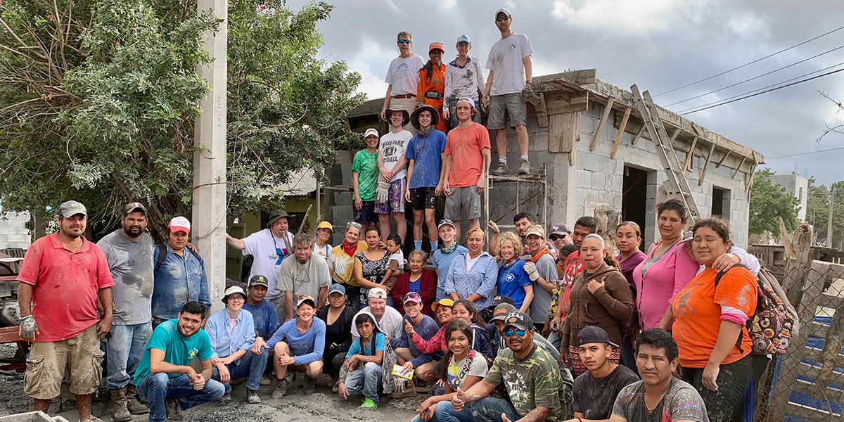 A team from North Carolina with the Reynosa staff and volunteers after pouring a roof