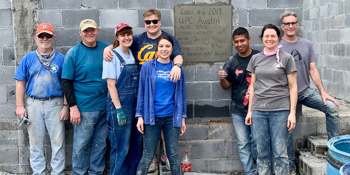 A team from Texas with the family they helped build a home for in Mexico