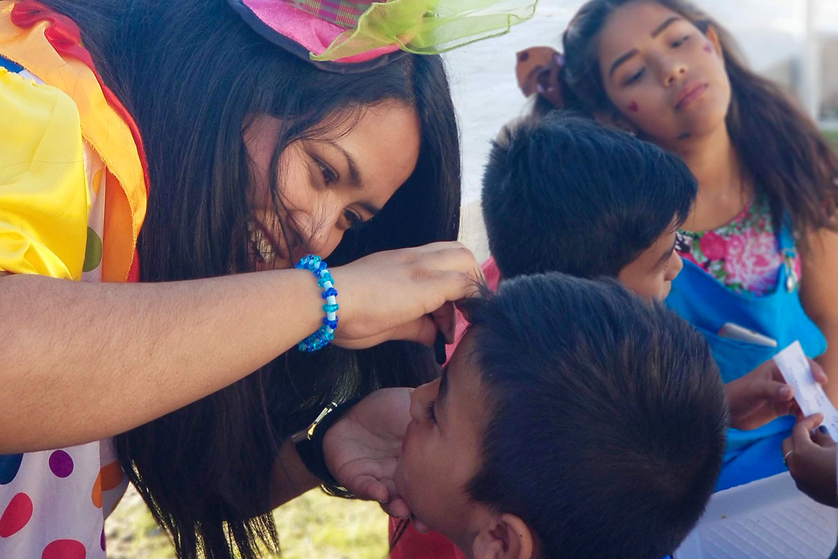 Face painting at the Childrens Day fiesta in Naranjito