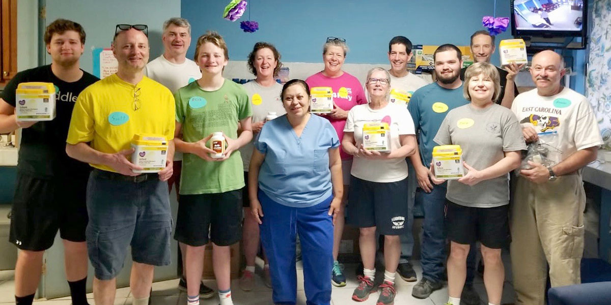 A team from North Carolina donating baby formula to nurse Betty at the clinic in Reynosa