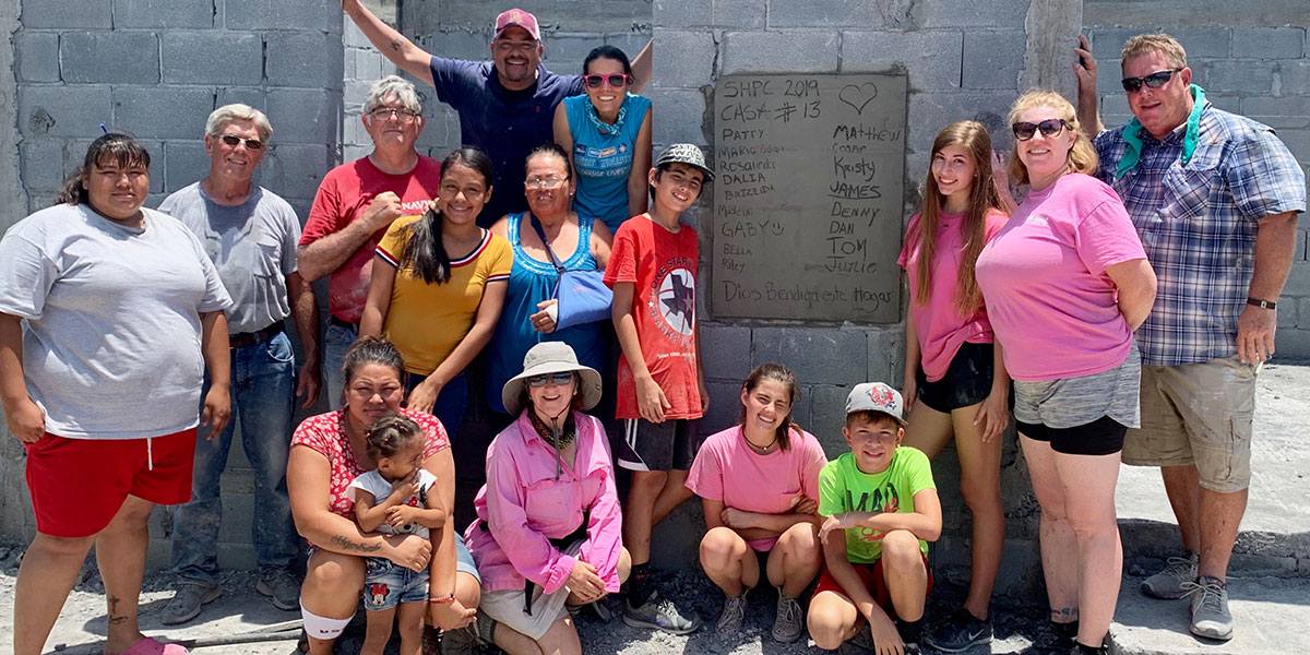 A team from Texas with the family they helped build a house for in Reynosa Mexico