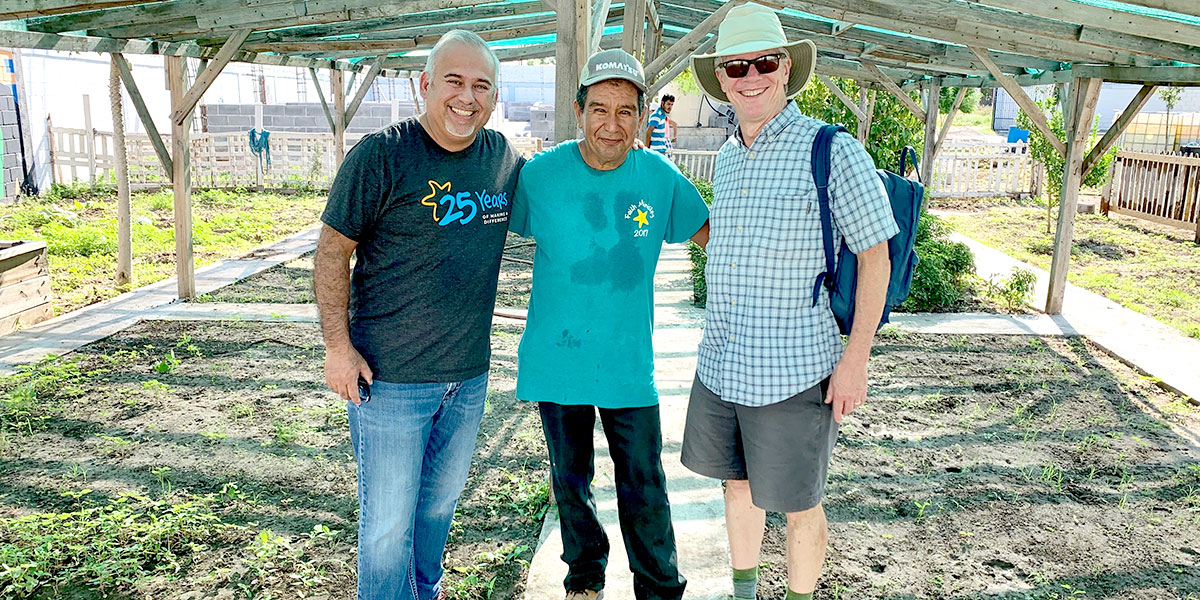 David and Jose with James at the garden in Naranjito
