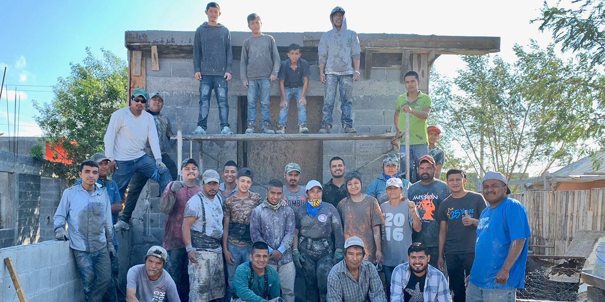 The staff and volunteers in Reynosa after pouring a roof for a house for a family in Mexico