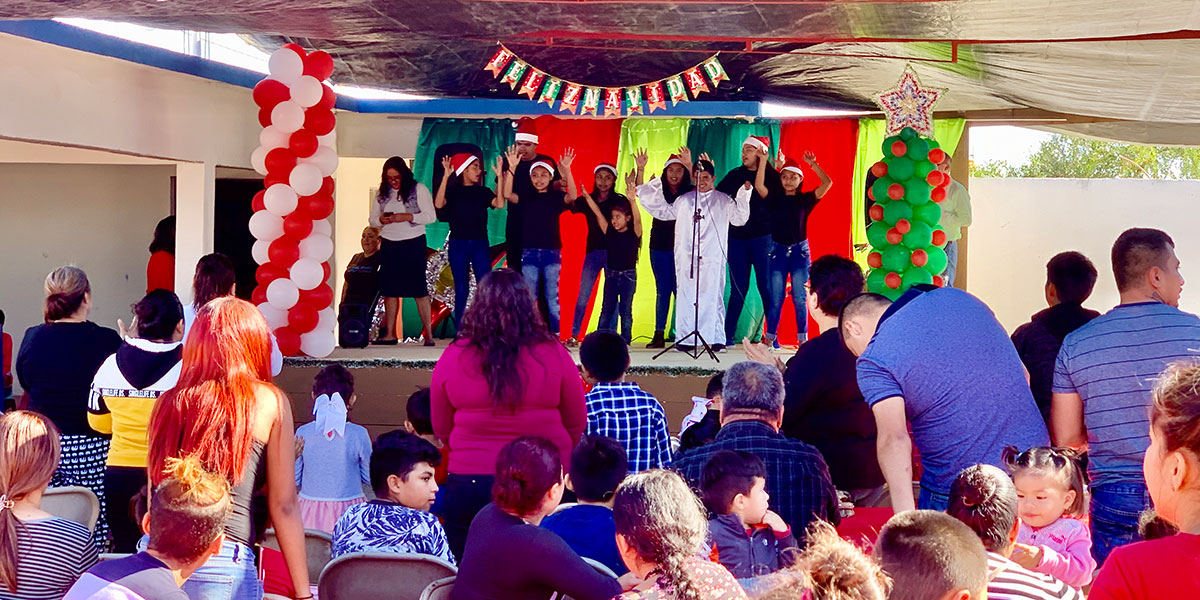 The youth from the church performing a song at the Christmas fiesta in Miguel Aleman