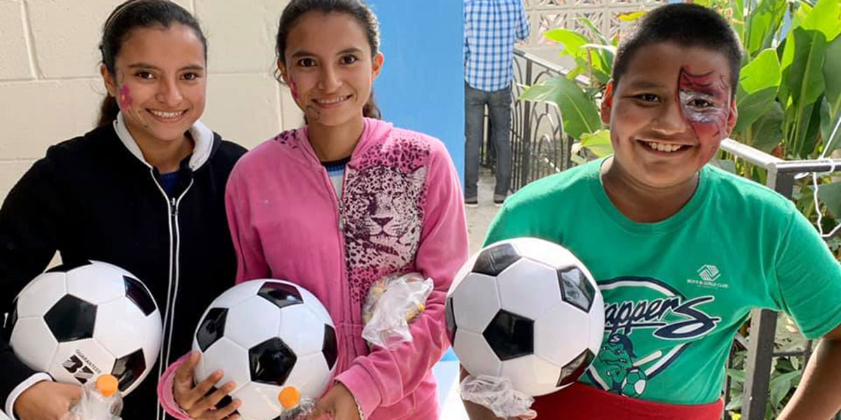 Kids with their new soccer balls at the Christmas fiesta in Reynosa