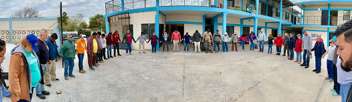 Staff volunteers and group members praying over the start of the week in Reynosa Mexico