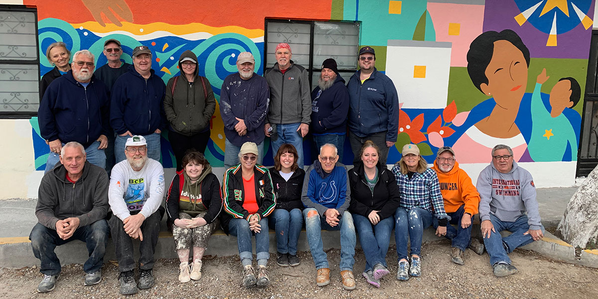 A team from Indiana in front of the mural they painted in Naranjito Mexico