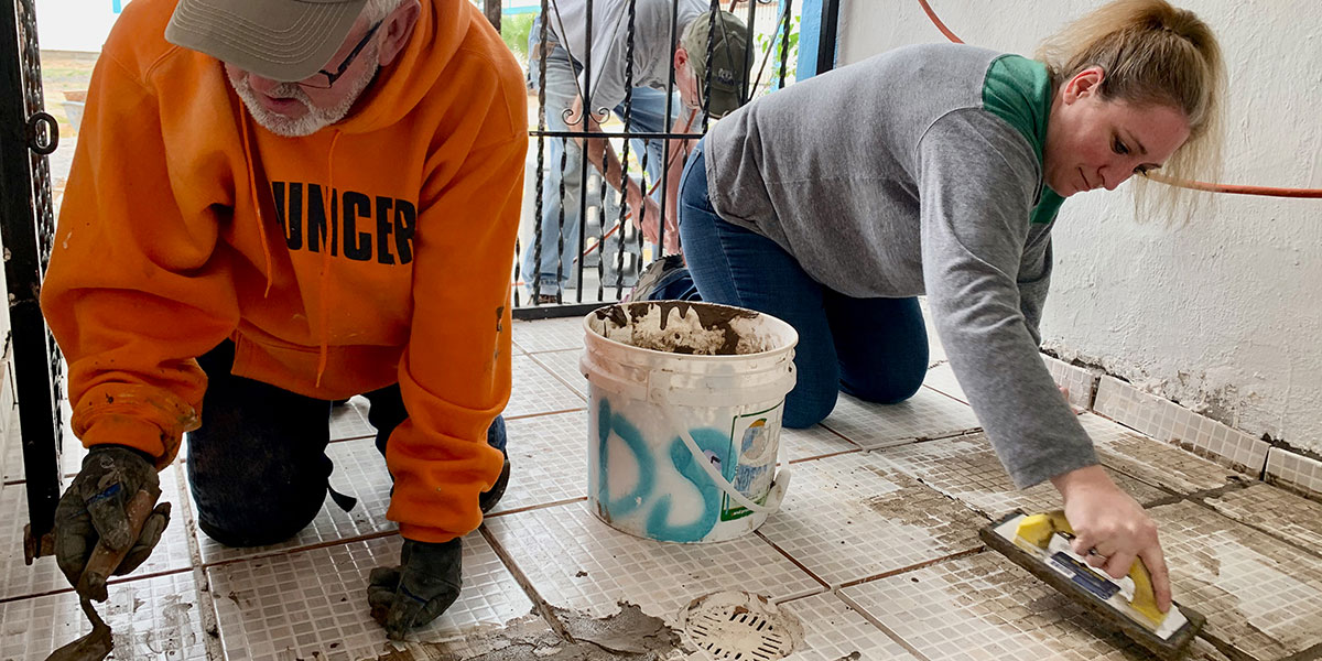 Friends from Indiana tiling the bathrooms in Naranjito Mexico