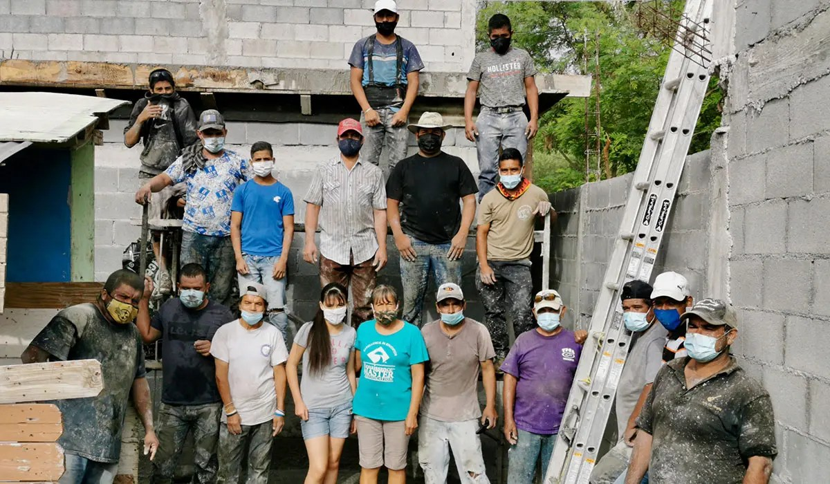 The family staff and extra workers after pouring the roof of Casa 3 in Reynosa Mexico