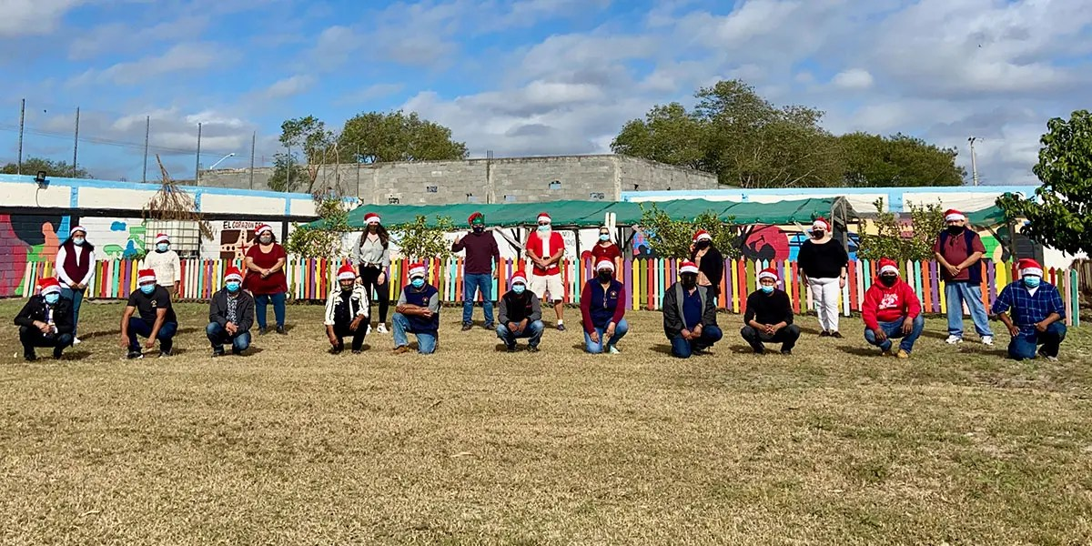 The staff safely gathered at our Christmas fiesta