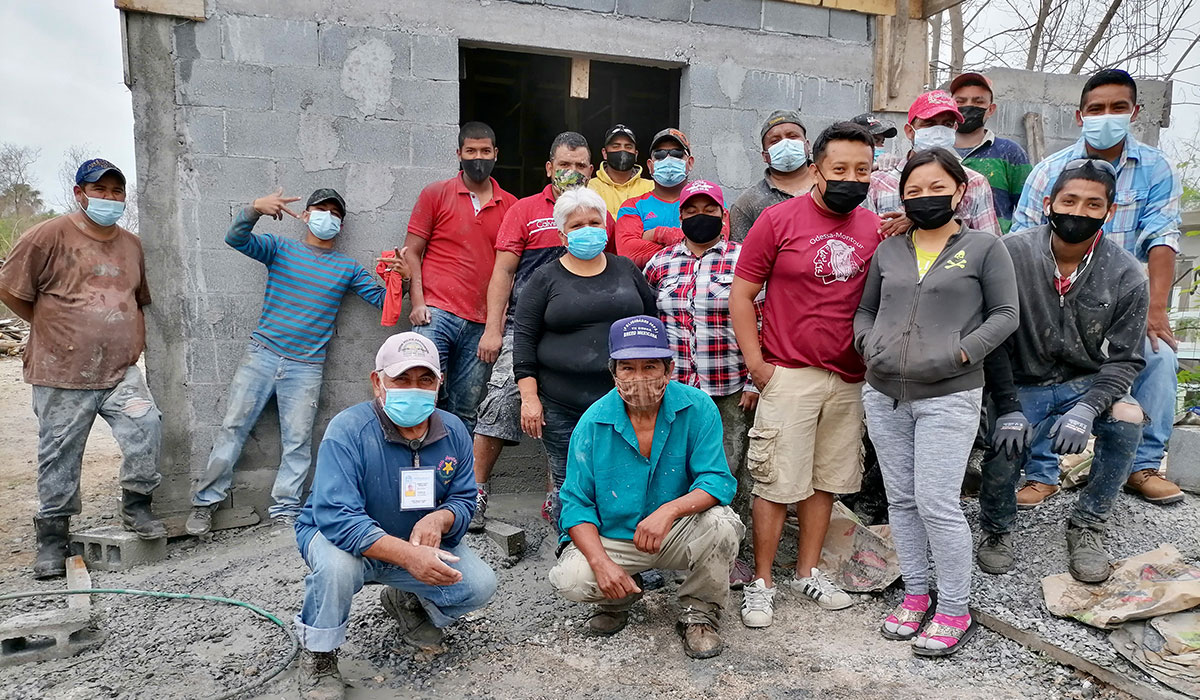 The family of Casa 2 with the staff and volunteers in Reynosa Mexico after pouring the roof of the house