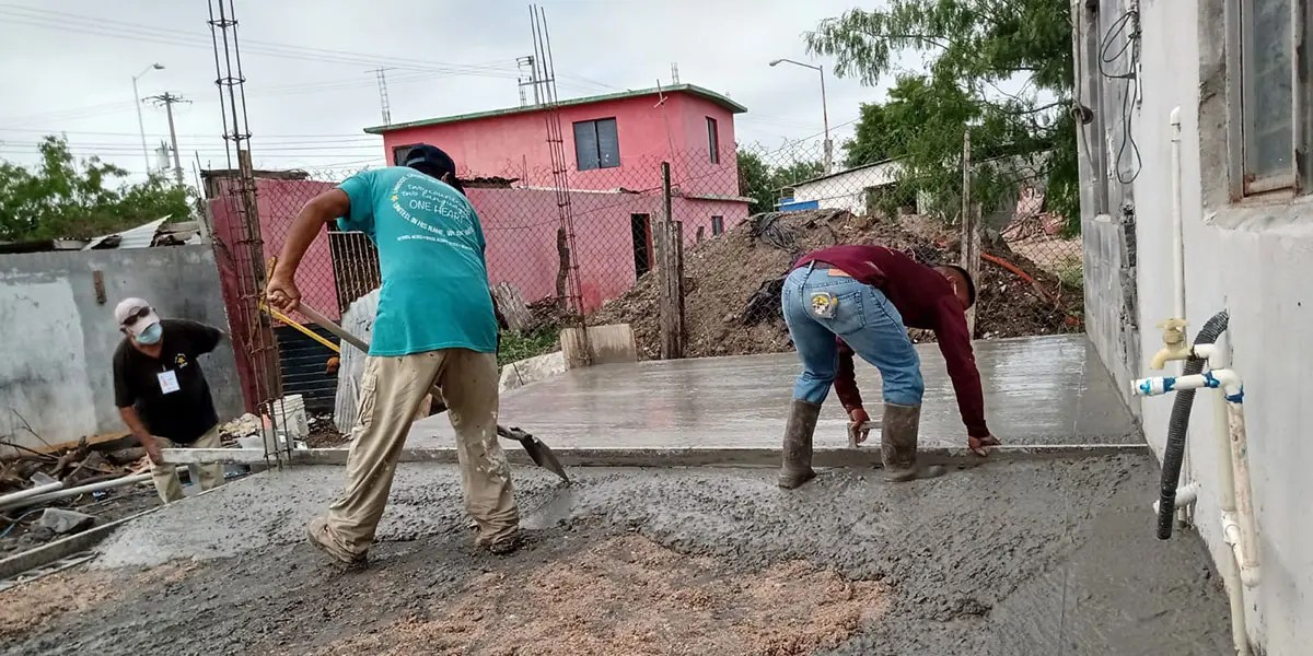 The staff and volunteers pouring the floor of Casa 4 in Reynosa Mexico