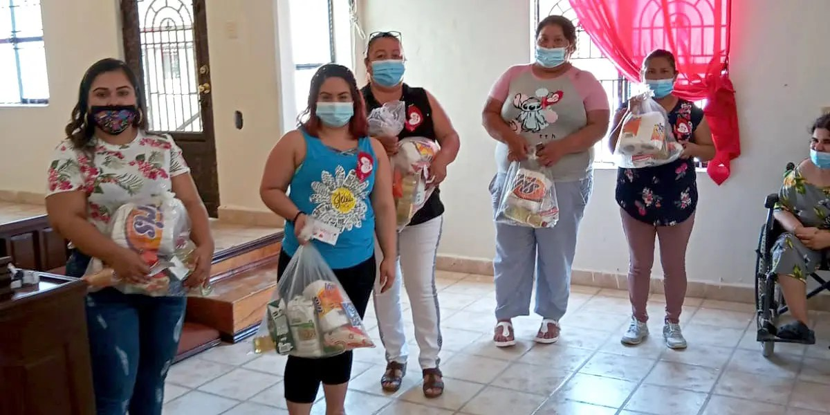 Giving out grocery packages to mothers in Miguel Aleman Mexico for Mothers Day