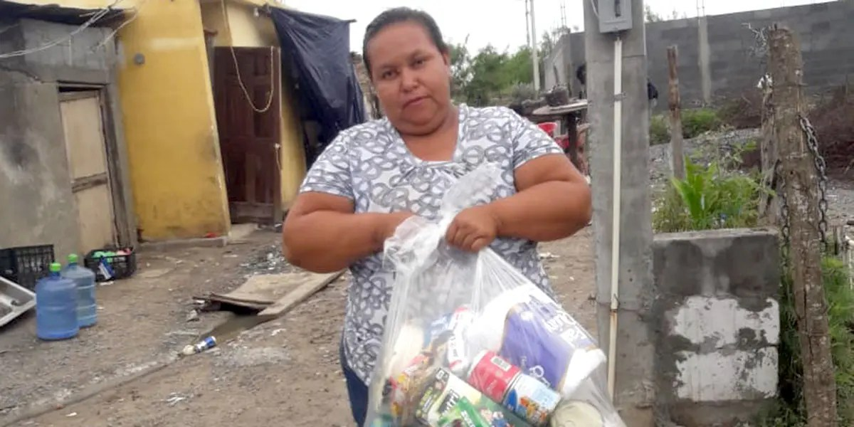 Distributing grocery packages for families in Miguel Aleman Mexico