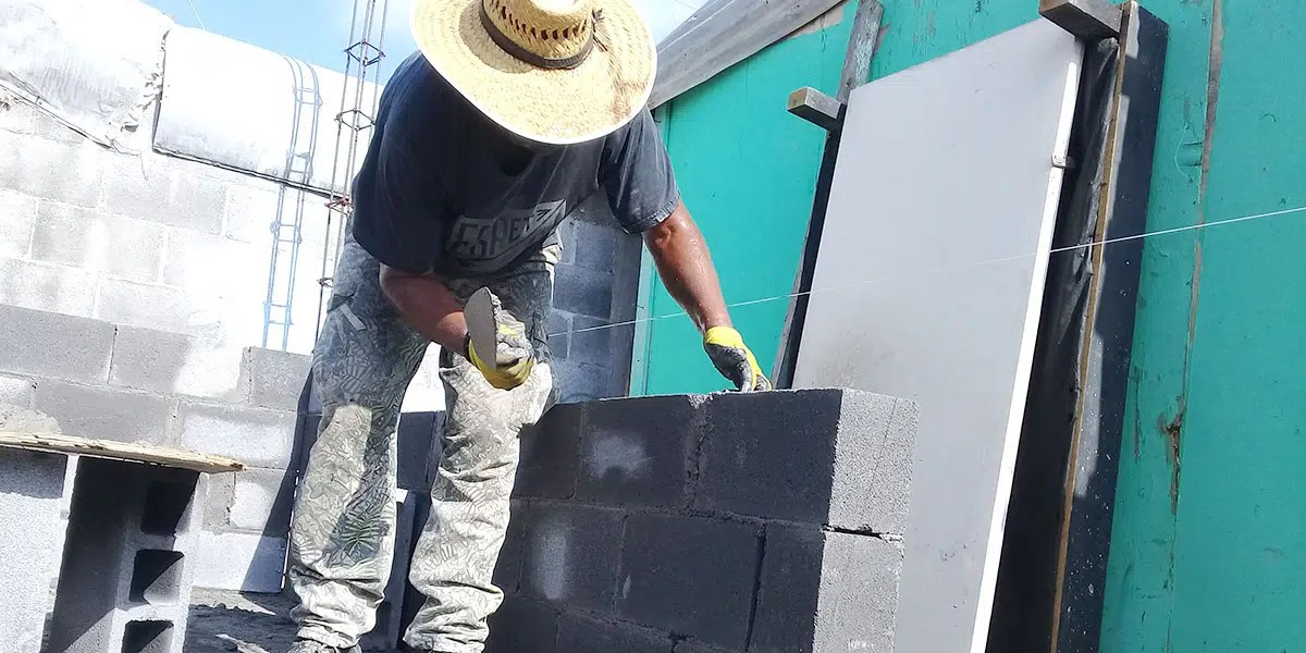 Our staff and volunteers building the walls of Casa 9 in Reynosa Mexico