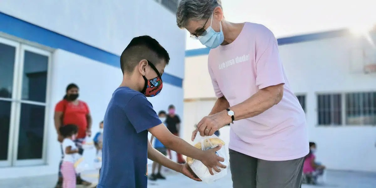 Helping hand out breakfast at the childrens nutrition program in Reynosa Mexico