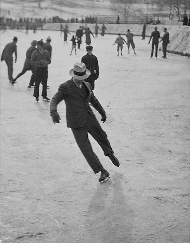 A man ice skating in a suit (1937).